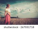 Beautiful Hippie Girl In A Field