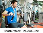 young man training in the gym   Shutterstock . vector #267033320