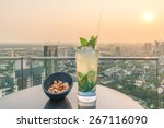 mojito cocktail and cashews on... | Shutterstock . vector #267116090