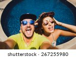 beautiful couple in caps and... | Shutterstock . vector #267255980