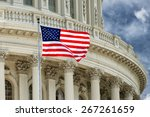 Stock photo washington dc capitol dome detail with waving american flag 267261659