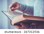 Young Woman Reading A Book....