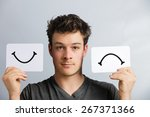portrait of a man holding happy ... | Shutterstock . vector #267371366