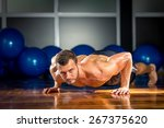 young adult man doing push ups... | Shutterstock . vector #267375620