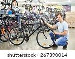 Man Checks A Bike Before Buyin...