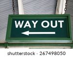 Green Way Out Sign at Railway Station - stock photo