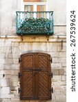 Old Rustic Wooden Gate On Ston...