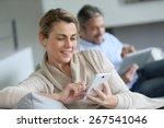 mature woman using smartphone ... | Shutterstock . vector #267541046