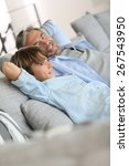 father and son relaxing in sofa ... | Shutterstock . vector #267543950
