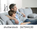 father and son relaxing in sofa ... | Shutterstock . vector #267544130