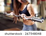 brutal athletic woman pumping... | Shutterstock . vector #267548048