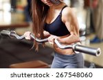 brutal athletic woman pumping... | Shutterstock . vector #267548060