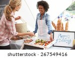 female bakery stall holder at... | Shutterstock . vector #267549416