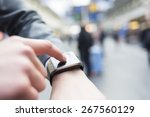 in hall station a man using his ... | Shutterstock . vector #267560129