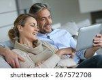 mature couple relaxing in sofa...   Shutterstock . vector #267572708