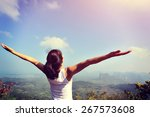 young woman cheering open arms... | Shutterstock . vector #267573608