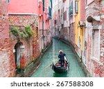venetian gondolier punting... | Shutterstock . vector #267588308