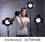 young female photographer... | Shutterstock . vector #267589388