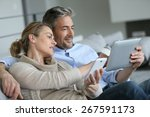 mature couple at home using... | Shutterstock . vector #267591173