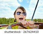 emotional girl in sunglasses in ... | Shutterstock . vector #267624410