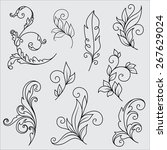 set of abstract flower ornaments   Shutterstock .eps vector #267629024