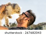 Stock photo dog and his owner cool dog and young man having fun in a park concepts of friendship pets 267682043