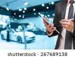 businessman using the tablet on ... | Shutterstock . vector #267689138