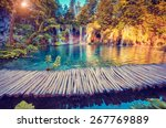 Small photo of Majestic view on turquoise water and sunny beams in the Plitvice Lakes National Park. Croatia. Europe. Dramatic unusual scene. Beauty world. Retro filter and vintage style. Instagram toning effect.