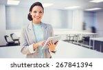 brunette using tablet pc... | Shutterstock . vector #267841394