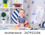 child on the carpet in the room ... | Shutterstock . vector #267922106