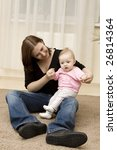 mother and baby playing in home | Shutterstock . vector #26814364