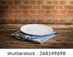 white plate on a napkin. on... | Shutterstock . vector #268149698