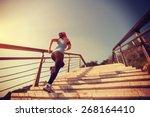 young  woman runner running up... | Shutterstock . vector #268164410