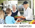 Stock photo pupils in school cafeteria being served lunch by dinner ladies 268247153