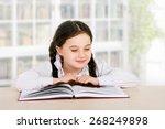 happy little girl child reads... | Shutterstock . vector #268249898
