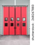 red garage door on a warehouse... | Shutterstock . vector #268267883
