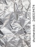 Small photo of Crumpled aluminum foil background.