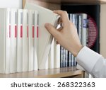 choosing book. hand of man in... | Shutterstock . vector #268322363