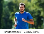 young man jogging | Shutterstock . vector #268376843
