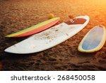 surfboards lying on the beach... | Shutterstock . vector #268450058