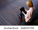 young female student sitting in ... | Shutterstock . vector #268455704