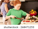 mother and child in the kitchen | Shutterstock . vector #268471253