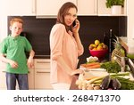 mother and child in the kitchen   Shutterstock . vector #268471370