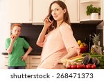 mother and child in the kitchen | Shutterstock . vector #268471373