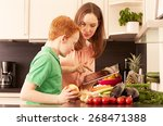 mother and child in the kitchen   Shutterstock . vector #268471388