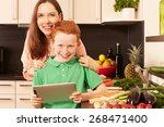 mother and child in the kitchen   Shutterstock . vector #268471400