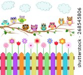 Stock vector cute owls on a branch 268545806