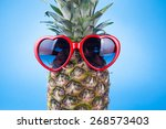 funny pineapple in a sunglasses ... | Shutterstock . vector #268573403