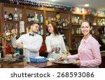 happy waitress and barmen... | Shutterstock . vector #268593086