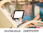 Woman Using Tablet Computer By...